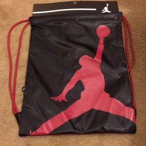 c3acf6a3be Nike Bags - Red and black Jordan jumpman drawstring backpack